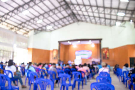 blurred school hall for background, blur people in the school auditorium, school event blur image