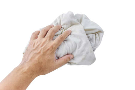 fabric dirty ragged in hand of man isolated on white, cleaning rag dry, dirty cloth, kitchen rag, washing, wiping, cleaning concept Stok Fotoğraf
