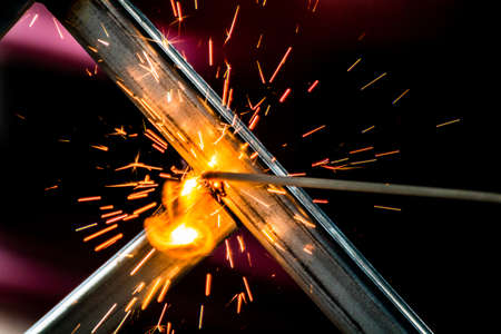 welding sparks, construction and metal work industrial concept, metal welding with sparks, laborer or labor day concept