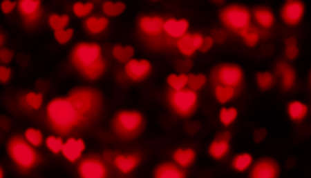 heart shape red light blurred for valentine's day background, red heart bokeh in dark night, glowing light with heart shape bokeh for abstract background