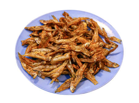 crispy deep-fried fish small in a plate, small fish fry salt