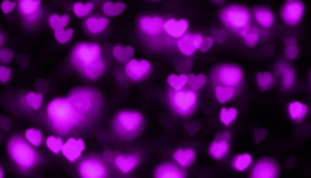 heart shape purple light blurred for LGBT background, valentine's day background, purple heart bokeh in dark night, glowing light with heart shape bokeh for abstract background Imagens