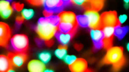 heart shape colorful light blurred for valentine's day background, colorful heart bokeh in dark night, glowing light with heart shape bokeh for abstract background