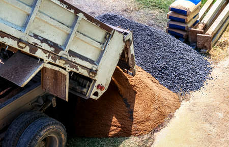 stone, sand pile and pickup truck at construction area, construction concept Stok Fotoğraf