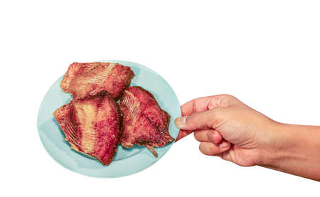 fried fish in a plate, fish fry, hand holding a plate of fried fish isolated on white