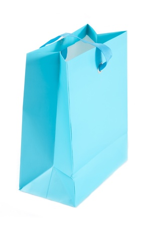 A photo of a blue bag isolated on white. photo
