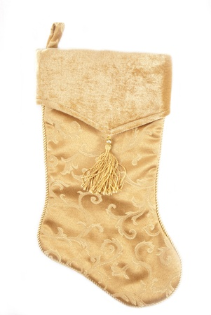 christmas decorations with white background: A close-up photo of a gold Christmas stocking.