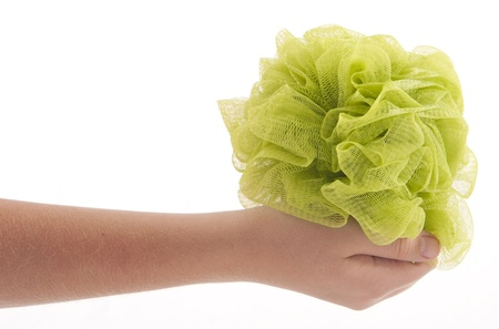 Hand grasping loofa photo