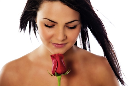 grasp: A beautiful young woman holds a red rose.