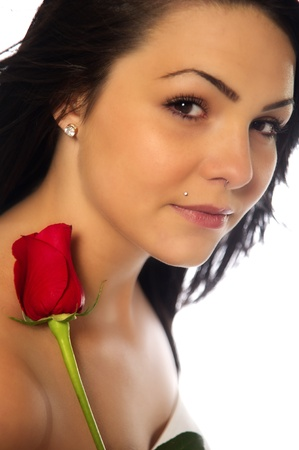 grasp: A dark-haired young woman holds a single red rose.