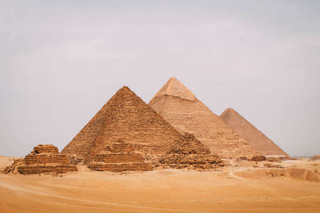 Panoramic view of the six great pyramids of Egypt. Pyramid of Khafre, pyramid of Khufu, and the red pyramid.
