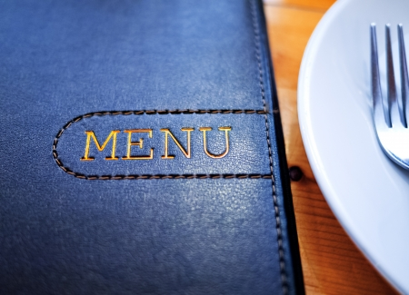 Black Leather Menu with White Plate on wood table