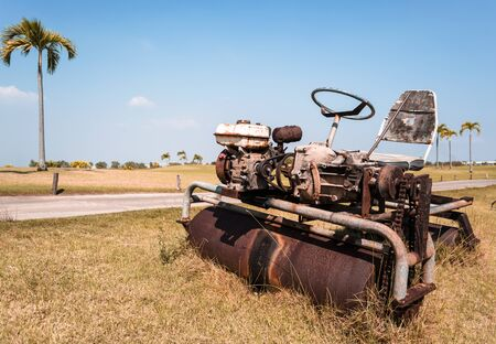Old Ride-on Lawn Roller on Dead lawn.Bankrupt concept.