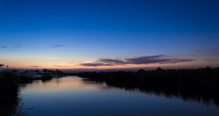 Beautiful sunset at the river lake, nice and colorful sky. Stock Photo