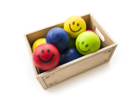 colorful Smiling Balls in the wood box Stock Photo