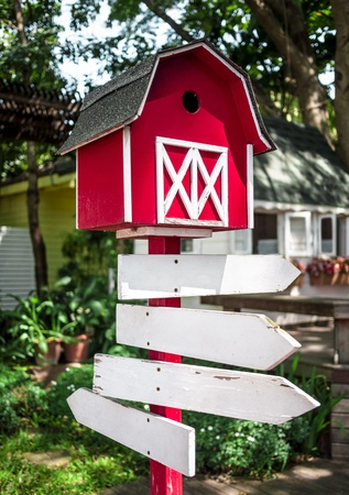 Red wood Mailbox with White sign.in a farm. Stock Photo
