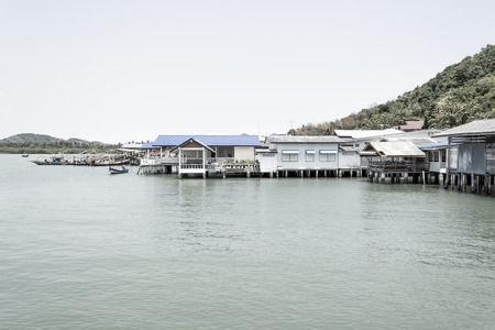 Thailand Fishing Village with a boat in the harbour. Stock Photo