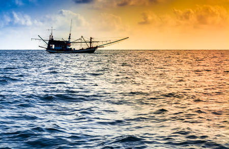 shrimp boat: Fishing boat on the water and dramatic clouds at.