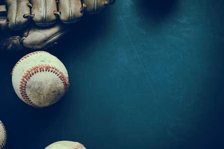 Old baseball with glove flat lay on grunge background with copy space for sports team season.