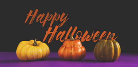 Halloween holiday graphic banner with text and mini pumpkins for October celebration.