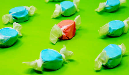 Saltwater Taffy candy closeup on green background.  Concept of diversity.