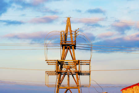 Power lines and tower against sunset sky for energy concept.