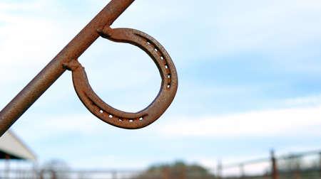 Rusty metal horse shoe on gate. Stok Fotoğraf