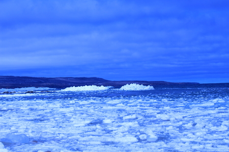 distance shot of escarpment and ice from blue ice wall Stock Photo