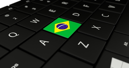 Close up of Brazil flag button on laptop keyboard.