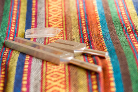 tuning fork and crystal on table.