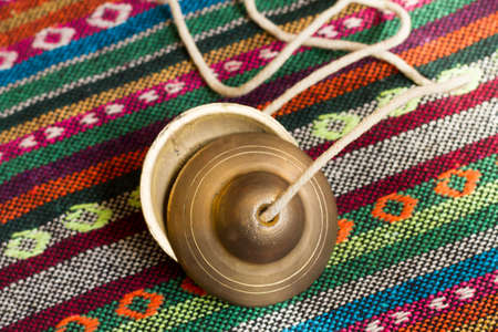 Tibetan bell tingsha on hand. Stock Photo