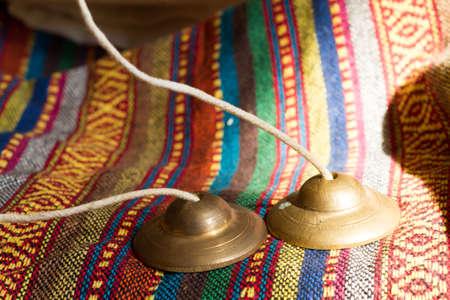 Tibetan bell tingsha on hand. Stock Photo