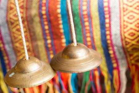 Tibetan bell tingsha on table. Stock Photo