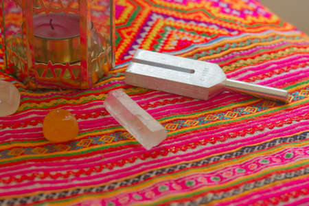 diapason: tuning fork and crystal on table.