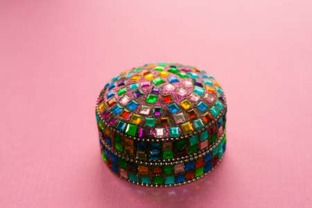 colorful indian box on pink table. Stock Photo