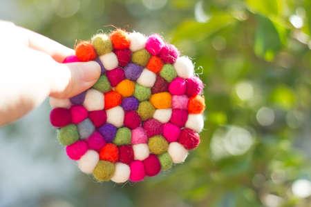 white fabric texture: colorful handmade fabric on tree . Stock Photo