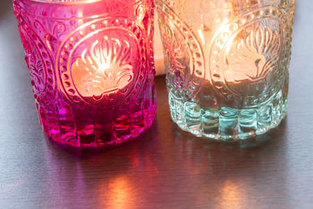 pink candle and light bule candle on a table . Banco de Imagens