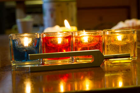 tuning fork and candles on table.