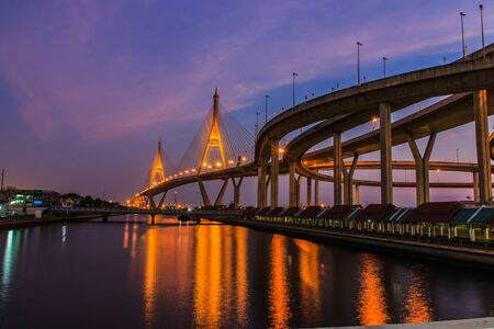 Lights and shadows on the water  The bridge crosses the Chao Phraya River for industrial ring road Thailand photo