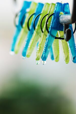 Clothes peg with water drops after rain in the morning  photo