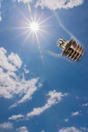 Idea, sun in the sky with a light bulb  版權商用圖片