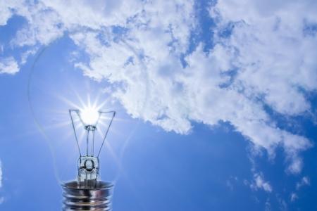 Idea, sun in the sky with a light bulb  photo
