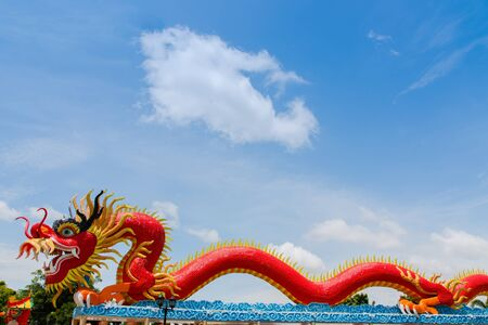Dragon statue with beautiful clouds and blue sky as background  photo