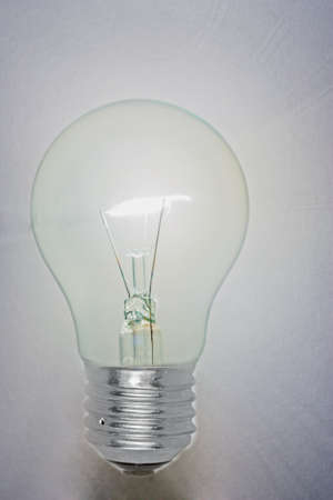 Light bulb shining on the white background. photo