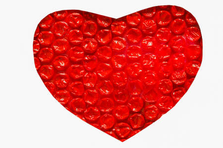 plastic heart: Red plastic heart with a white background  Stock Photo