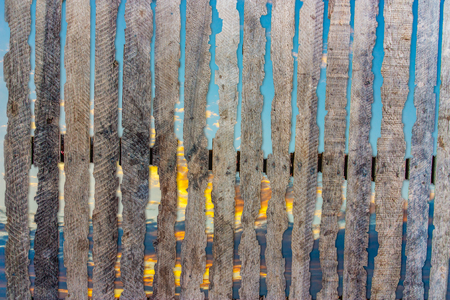 Old wooden fence on a background of the sky  photo