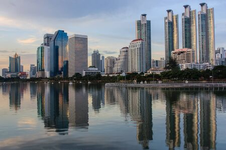 Commercial buildings with shadows on the water in the evening of Bangkok in Thailand  photo