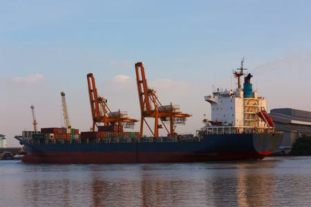 phraya: Cargo ship in Chao Phraya River of Thailand.