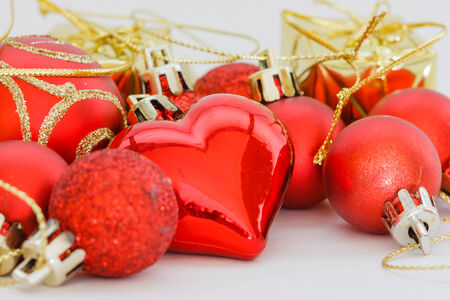 Red heart and Christmas ball ornaments on background  photo