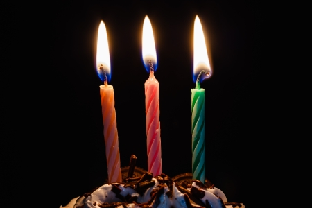 volumes: candles Three volumes, embroidered on the cake. Stock Photo